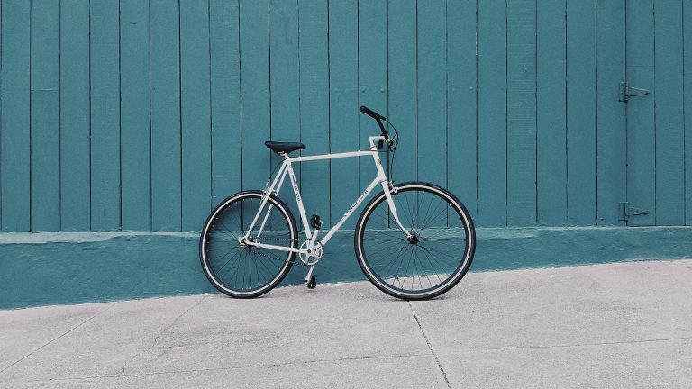 comfort bike against blue wall