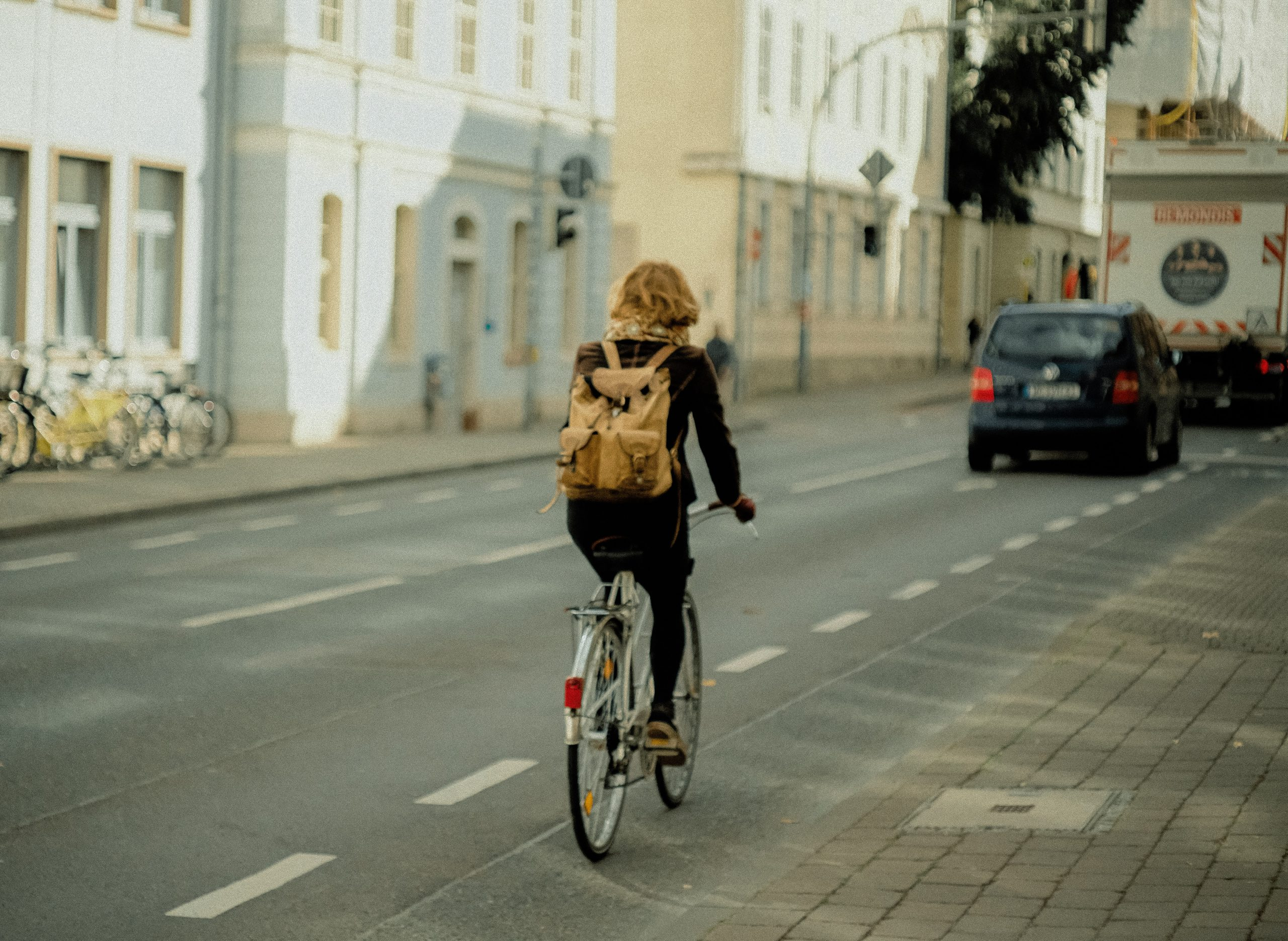 cover image showing cyclist on road